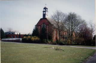The 'Church Tower', Brockhall. This was the gym in the later years of the institution. The image is dated 1993, so was taken after Brockhall had closed in 1992.  | Lancashire County Museums Service