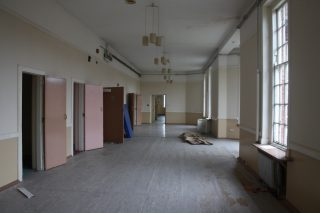 A photograph of the inside of Calder Avenue. Taken in 2016 this former ward was unused. Some of the doors on the left as you look are side rooms.