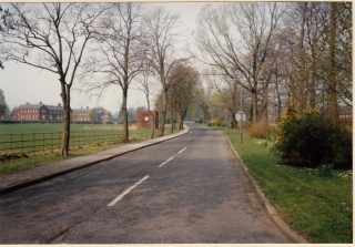 Entering Brockhall with wards on the left. This photo was taken in 1993 after the hospital had closed.  | Lancashire County Council Museums Service
