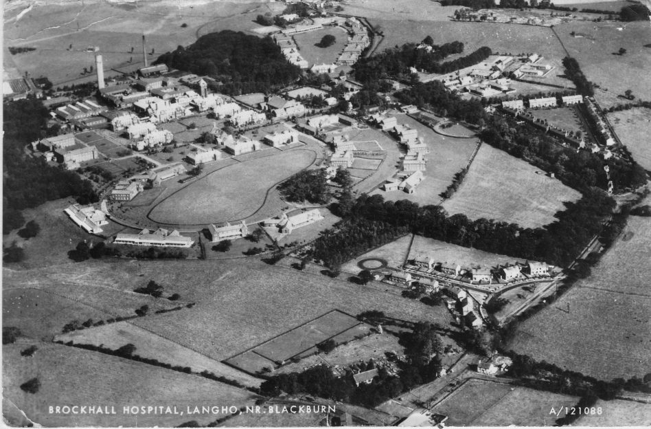 On this aerial view you can see the large circle of buildings in the foreground which was the female side of Brockhall. In the distance the other circle of buildings, with the tree in the middle, consisted of all the adult male wards. The date for the photograph is unclear. It is likely to be before the 1980s. The photograph is part of the album called - Brockhall Photo Album 1980-85.  | Courtesy of Lancashire County Council Museums Service