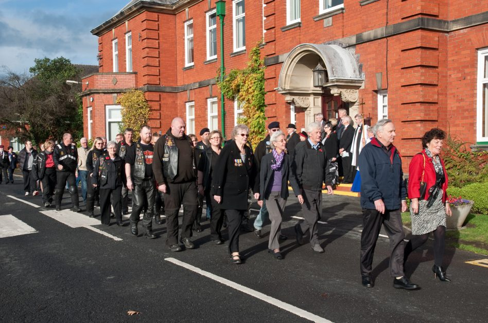 Remembrance Day Parade at Calderstones. This is an annual event in early November to remember the military personnel who died in the World Wars. It passes from the Calderstones site to the Commonwealth War Graves, at the edge of Whalley, where those who died at Queen Mary's Hospital are buried. This photo was taken by John Rowbotham at some point in the 2010s.  | Courtesy of Mersey Care NHS Foundation Trust