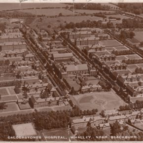 An aerial view of Calderstones (no date). The hospital cemetery is in the far top right corner of the photo - the field behind the white-ish building. You can see the avenue of trees which leads to the graveyard from Mitton Road.  | Courtesy of Brenda Kay