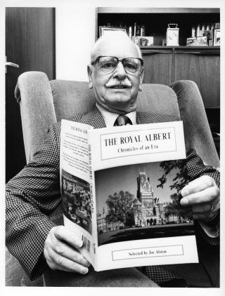 Mr. Joe Alston (c. 1992) with a book on the Royal Albert. After retirement in 1978, Joe Alston explored the institution's records from its beginnings in 1864, up until it became part of the National Health Service in 1948. The book is a result of his research, along with the editorial and writing expertise of Dr Elizabeth Roberts, an eminent oral historian. A concluding chapter was written by Otto Wangermann, former senior Clinical Psychologist at the Royal Albert. Alston, J. and E. Roberts (1992). The Royal Albert Hospital: Chronicles of an era Centre for North-West Regional Studies, University of Lancaster  | Courtesy of Joe Alston