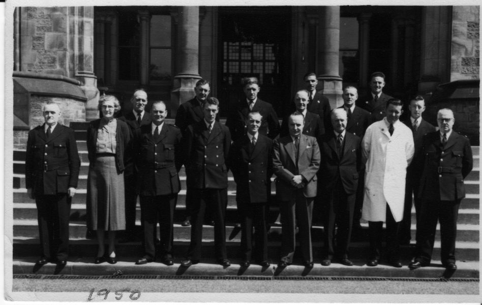Some of the senior (male nursing mainly) staff at the Royal Albert, 1950. They are standing on the institution's main entrance steps.  | Maureen Gerrard