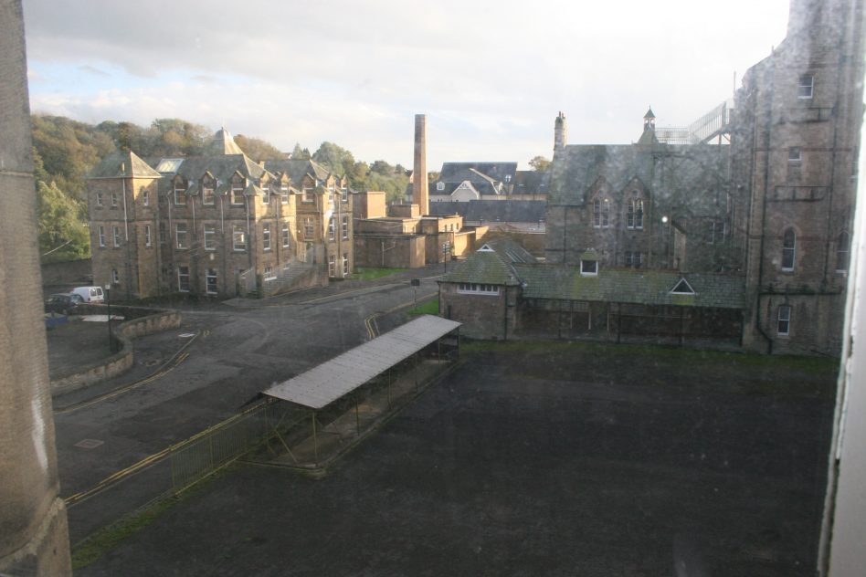 The view south from what used to be Coupland Ward, the Royal Albert. In the foreground is what was called the 'Boys' Yard' with male wards on the right. In the near distance is the Royal Albert's former boiler house.  | Mandy Cody